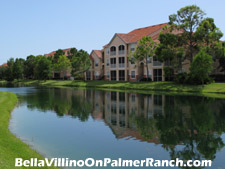 Many of the units in Bella Villino in Sarasota, FL look out from their lanai to a view over the lake